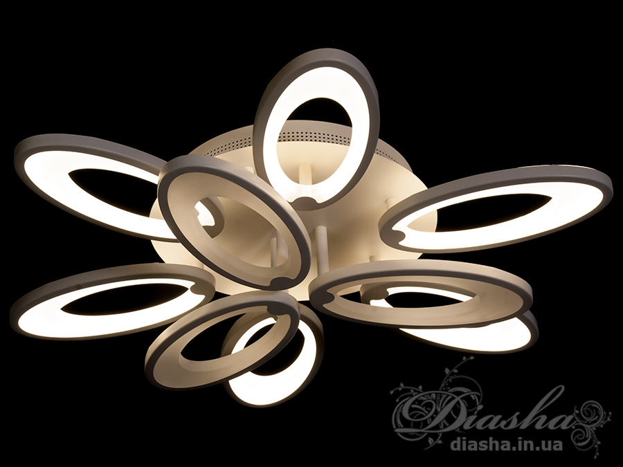Перед Вами совсем новое и необычное исполнение плафонов, обрамляющих LED лампы. Такая люстра запросто подойдет под любой интерьер – классический, современный и даже в стиле «хай-тек».Рассеиватель выполненный из литого акрила равномерно распределяет свет по помещению. При этом сам светится очень мягко. Вы можете смотреть на включенную люстру и не бояться словить