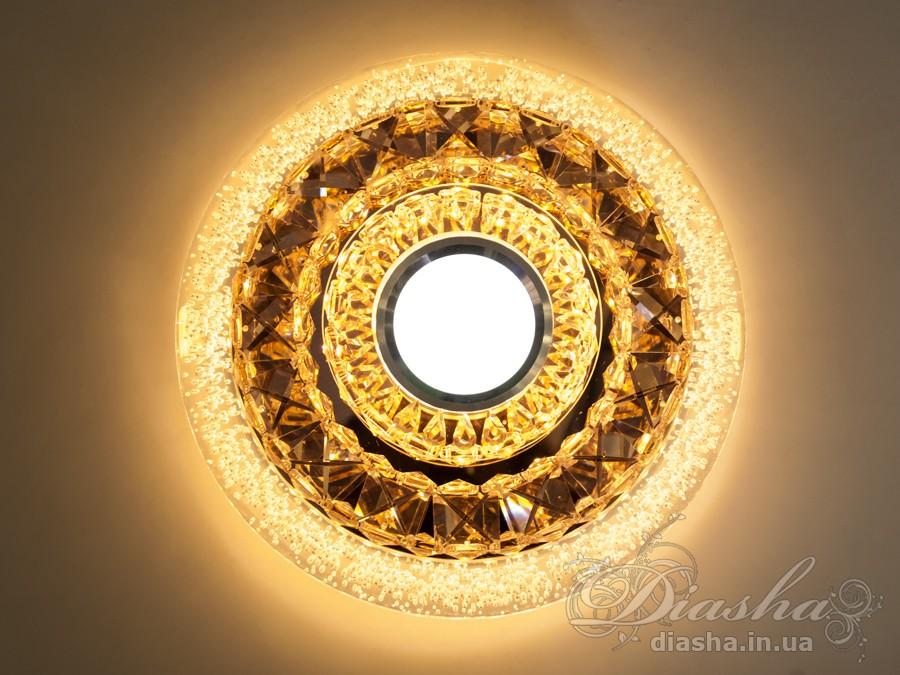 Светильник оснащен встроенным LED модулем 15W. Светодиодный свет преломляется в сотнях граней точечного светильника и равномерно распределяется по помещению.Светильник экономичен, красив, современен и изготовлен из качественного хрусталя, что обеспечивает ему хорошее преломление света и образование четких ярких бликов.Светильники этой модели могут быть установлены в отверстие 100мм, или как накладные светильники. Весь необходимый крепеж в комплекте. Точечные светильники просты и легки в установке, поэтому их монтаж не займет много времени и труда. Они запросто могут изменить пространство помещения. Если точечные светильники установить по периметру потолка, то он будет казаться выше, а сама комната – намного больше.Примите это как руководство к действию. И тогда эти хрустальные точечные светильники будутспособны обеспечить Вам комфорт именно на том уровне, которого Вы так долго ждали!Лампа в комплект не входит.