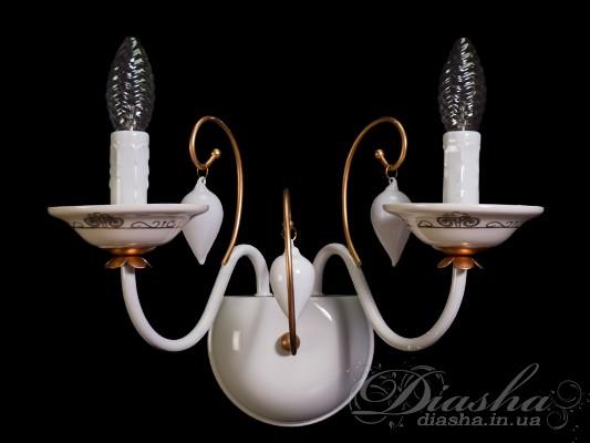 Солидность, строгость и простота - эти понятия идеально переплелись в новой серии классических светильников Диаша. Грациозное металлическое основание с изящными и лаконичными хрустальными подвесками. Эти люстры и бра способны идеально подходить как к классическиим так и к современным интерьерам, и даже хай-тек!!! Классические люстры и бра этой модели с обыкновенными лампами накаливания или экономками на патрон Е14 внесут классические нотки в любой интерьер!