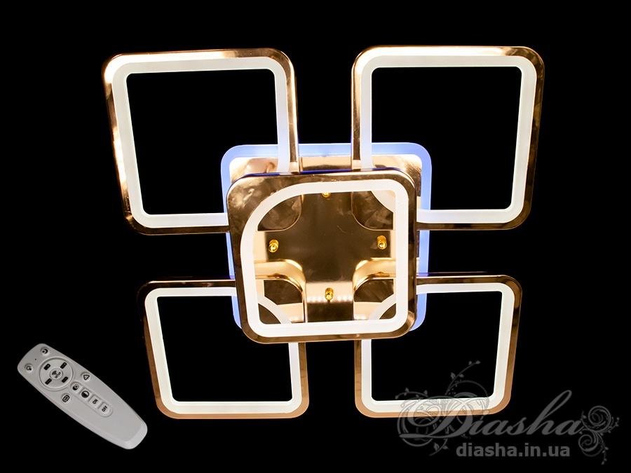 Встречайте самую хитовую модель в золотом и хромированном исполнении!Светодиодная люстра имеет несколько режимов: холодный 6400К, нейтральный 4500К, тёплый 2700К, синяя LED подсветка, красная LED подсветка, розовая LED подсветка, совмещённый режим — любой основной свет плюс любой цвет светодиодной подсветки — всё зависит от вашего настроения!Потолочный светильник имеет электронный димер, что позволяет регулировать яркость люстры от 5% до 100% при помощи пульта, который поставляется вместе с люстрой.Люстра светит ярко, но не слепит за счёт материала — акрила, к тому же этот материал очень прочен — его трудно повредить.Лёгкий вес, небольшая высота, оригинальный дизайн с хромированными или золотыми частями, пульт, димер, дополнительная подсветка разных цветов — вам обязательно понравятся наши люстры!
