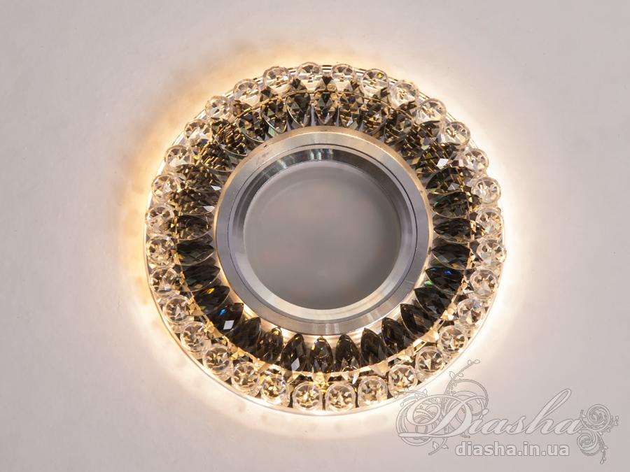 Врезные хрустальные точечные светильники под лампу MR-16это новые технологии в точечном освещении! Светильник оснащен встроенным LED модулем 5W, что дает ему возможность распределения на три включения (двойной выключатель): лампа, встроенная подсветка, и одновременно и лампа и подсветка. Режим подсветки можно использовать, как самостоятельный заполняющий свет - свет преломляется в сотнях граней точечного светильника и равномерно распределяется по помещению. Основная лампа стандарта MR-16 наоборот даёт основную часть светового потока строго вниз - этот режим хорош для подсветки стола/рабочей поверхности, чтения и тд.Светильник экономичен, красив, современен и изготовлен из качественного хрясталя, что обеспечивает ему хорошее преломление света и образование четких ярких бликов.  Точечные светильники просты и легки в установке, поэтому их монтирование не займет много времени и труда. Они запросто могут изменить пространство помещения. Если точечные светильники установить по периметру потолка, то он будет казаться выше, а сама комната – намного больше. Конструкция светильника идеально расчитана на использование с натяжными потолками. Примите это как руководство к действию. И тогда эти хрустальные точечные светильники будутспособны обеспечить Вам комфорт именно на том уровне, которого Вы так долго ждали! Для оптовых покупателей отпускается только ящиками по 50 шт. Лампа в комплект не входит.