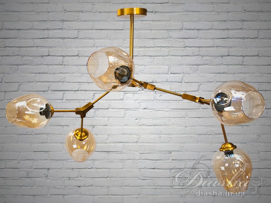 Лаконичный и в тоже время очень стильный дизайн этой люстры на 5 ламп в стиле лофт подойдет для ценителей минимализма и свободы мысли в интерьере.Стиль «Лофт» сейчас очень популярен, его любят как творческие личности, так и весьма практичные люди, предпочитающие комфорт и простоту в интерьере. Люстры в стиле «лофт» идеально впишутся в современные дома, квартиры, кафе, арт-пространства, коворкинги, квеструмы. За счет регулировки шнура можно подобрать оптимальную высоту светильника.Несмотря на похожесть люстры на привычных представителей серии