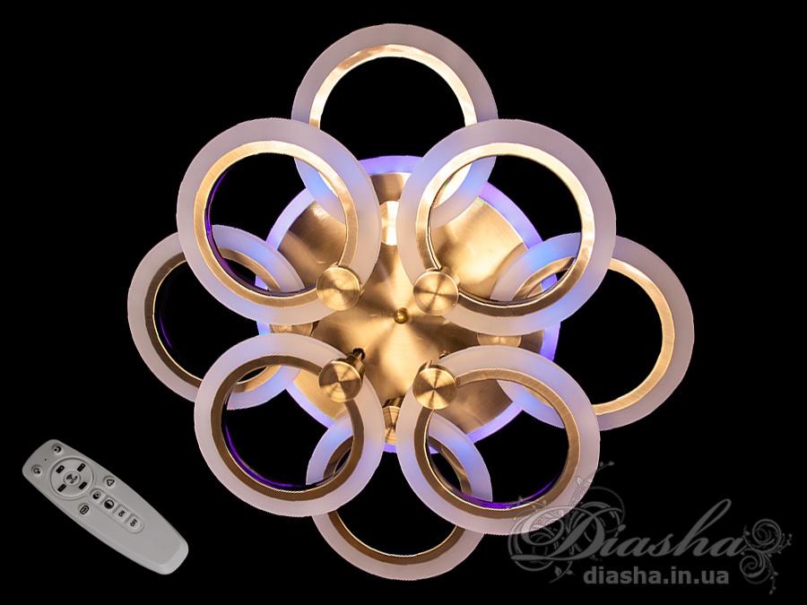 Перед Вами совсем новое и необычное исполнение плафонов, обрамляющих LED лампы. Такая люстра запросто подойдет под любой интерьер – классический, современный и даже в стиле «хай-тек».Светодиодная люстра имеет несколько режимов: холодный 6400К, нейтральный 4500К, тёплый 2700К, синяяLEDподсветка, краснаяLEDподсветка, розоваяLEDподсветка, совмещённый режим — любой основной свет плюс любой цвет светодиодной подсветки — всё зависит от вашего настроения!Потолочный светильник имеет электронный димер, что позволяет регулировать яркость люстры от 5% до 100% при помощи пульта, который поставляется вместе с люстрой.Люстра светит ярко, но не слепит за счёт материала — акрила, к тому же этот материал очень прочен — его трудно повредить.Лёгкий вес, небольшая высота, оригинальный дизайн с хромированными или золотыми частями, пульт, димер, дополнительная подсветка разных цветов — вам обязательно понравятся наши люстры!