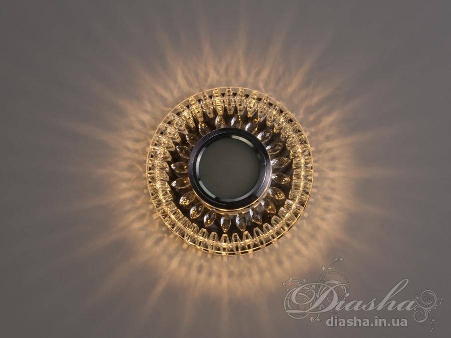 Врезные хрустальные точечные светильники под лампу MR-16это новые технологии в точечном освещении! Светильник оснащен встроенным LED модулем 5W, что дает ему возможность распределения на три включения (двойной выключатель): лампа, встроенная подсветка, и одновременно и лампа и подсветка. Режим подсветки можно использовать, как самостоятельный заполняющий свет - свет преломляется в сотнях граней точечного светильника и равномерно распределяется по помещению. Основная лампа стандарта MR-16 наоборот даёт основную часть светового потока строго вниз - этот режим хорош для подсветки стола/рабочей поверхности, чтения и тд.Светильник экономичен, красив, современен и изготовлен из качественного хрясталя, что обеспечивает ему хорошее преломление света и образование четких ярких бликов. Точечные светильники просты и легки в установке, поэтому их монтирование не займет много времени и труда. Они запросто могут изменить пространство помещения. Если точечные светильники установить по периметру потолка, то он будет казаться выше, а сама комната – намного больше.Примите это как руководство к действию. И тогда эти хрустальные точечные светильники будутспособны обеспечить Вам комфорт именно на том уровне, которого Вы так долго ждали!Лампа в комплект не входит.