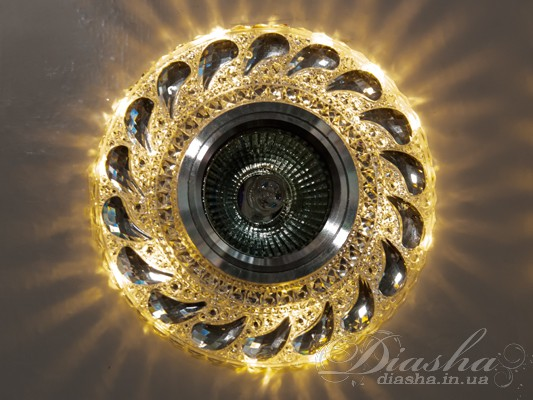 Обычно точечные светильники предназначаются для подвесных потолков и для подсветки различных нишили рабочей поверхности. Конструктивно точечный светильник состоит из двух частей: видимой - декоративной и встроенной – функциональной. Функциональная часть светильников состоит из каркаса, куда вставляется источник света и крепится декоративная часть, а также зажимов, которые предназначены для крепления светильника к потолку. Разнообразие декоративной части точечных светильниковпозволяет сделать Ваш интерьер неповторимым. Главные качества современных точечных светильников – это равномерное освещение всего помещения с возможностью акцентирования необходимых деталей интерьера.Точечные светильники произведенные из оптической смолы лучшее решение для натяжных потолков. Лёгкий корпус с оптическими характеристиками близкими к хрусталю. Стойкий к механическим повреждениям. Большой выбор моделей и цветов светильников.В светильник встроена подсветка мощностью 3Вт (цветовая температура 3200K - тёплый белый).Для оптовых покупателей отпускается только ящиками по 50шт.Лампа MR-16 и трансформатор в комплект не входят.