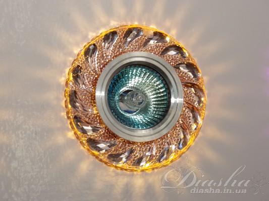 Обычно точечные светильники предназначаются для подвесных потолков и для подсветки различных нишили рабочей поверхности. Конструктивно точечный светильник состоит из двух частей: видимой - декоративной и встроенной – функциональной. Функциональная часть светильников состоит из каркаса, куда вставляется источник света и крепится декоративная часть, а также зажимов, которые предназначены для крепления светильника к потолку. Разнообразие декоративной части точечных светильниковпозволяет сделать Ваш интерьер неповторимым. Главные качества современных точечных светильников – это равномерное освещение всего помещения с возможностью акцентирования необходимых деталей интерьера.Точечные светильники произведенные из оптической смолы лучшее решение для натяжных потолков. Лёгкий корпус с оптическими характеристиками близкими к хрусталю. Стойкий к механическим повреждениям. Большой выбор моделей и цветов светильников.В светильник встроена подсветка мощностью 3Вт (цветовая температура 2700К - тёплый белый).Для оптовых покупателей отпускается только ящиками по 50шт.Лампа MR-16 и трансформатор в комплект не входят.