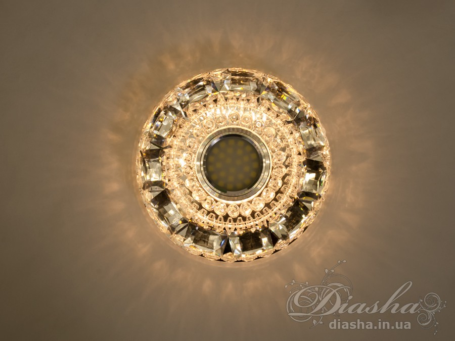 Врезные хрустальные точечные светильники под лампу MR-16это новые технологии в точечном освещении! Светильник оснащен встроенным LED модулем 5W, что дает ему возможность распределения на три включения (двойной выключатель): лампа, встроенная подсветка, и одновременно и лампа и подсветка. Режим подсветки можно использовать, как самостоятельный заполняющий свет - свет преломляется в сотнях граней точечного светильника и равномерно распределяется по помещению. Основная лампа стандарта MR-16 наоборот даёт основную часть светового потока строго вниз - этот режим хорош для подсветки стола/рабочей поверхности, чтения и тд.Светильник экономичен, красив, современен и изготовлен из качественного хрясталя, что обеспечивает ему хорошее преломление света и образование четких ярких бликов. Точечные светильники просты и легки в установке, поэтому их монтирование не займет много времени и труда. Они запросто могут изменить пространство помещения. Если точечные светильники установить по периметру потолка, то он будет казаться выше, а сама комната – намного больше.Примите это как руководство к действию. И тогда эти хрустальные точечные светильники будутспособны обеспечить Вам комфорт именно на том уровне, которого Вы так долго ждали! Для оптовых покупателей отпускается только ящиками по 50 шт.Лампа в комплект не входит.